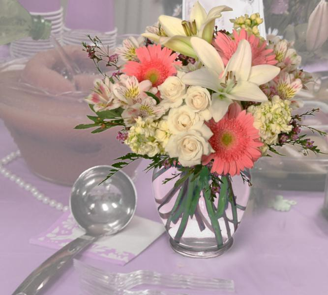 What better way to announce the birth of a new baby girl than with flowers? It's A Girl shower flowers add grace and elegance to your baby shower.