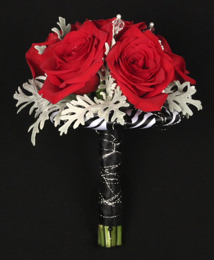 This prom bouquet features beautiful red flowers with unique red ribbon to finish it off.