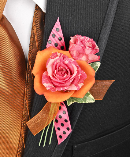 [Image: This orange and pink prom corsage features an orange flower with a pink flower inside of it to make a great contrast of colors. Plus, the added accent of the polka dot & orange ribbon makes it stand out.]