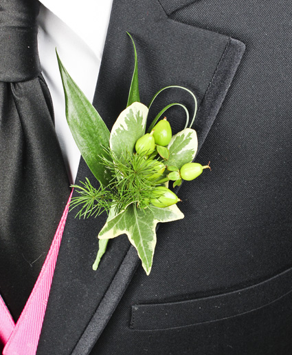 This prom boutonniere features the color green throughout every aspect.