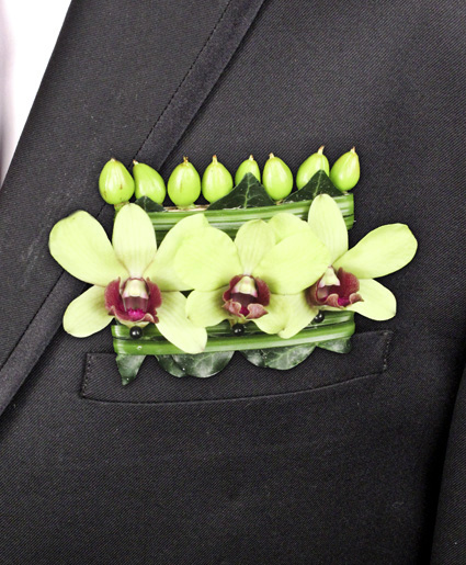 [Image: This is a unique take on a pocket square with the green flowers and fun details.]